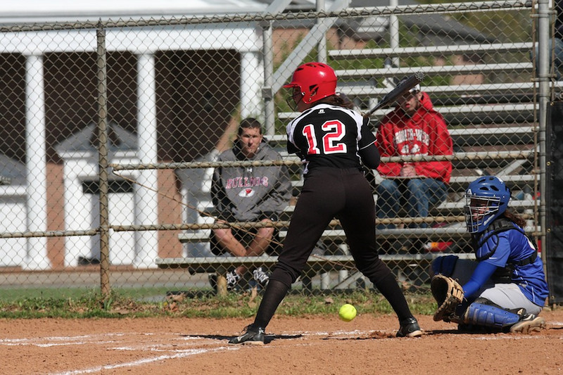 Number 12, Lindsea Hutchinson, holds her ground as the low pitch goes by.