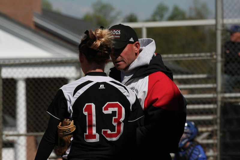 Head Coach Tom Cole talks with number 13, Jordyn Arrowood.