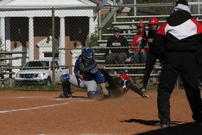 Number 12, Lindsea Hutchinson, slides into home.