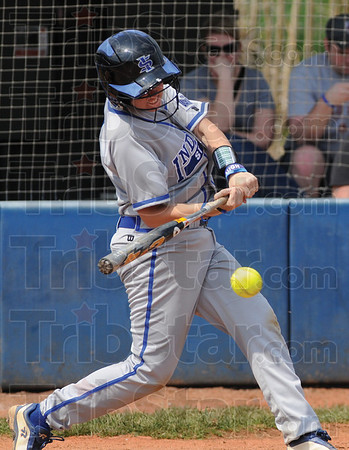 Tribune-Star/Rachel Keyes<br /> Hard hit: Indiana State's Steviee Grove takes a hard swing at the ball in action on Sunday against Evansville.