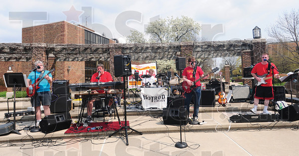 Tribune-Star/Rachel Keyes<br /> Rock 'n' the walk: Hotrod Lincoln Tim Murphy (far left) Dave LaMarche (left) Randy Dale (middle) Jim Pinkstaff (right) and Shawn Hawley (far right) a local band supplied the entertainment for Sunday's Homeward Bound Walk.