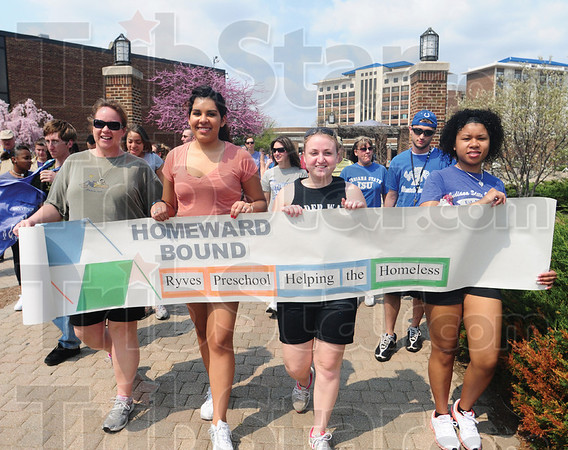 Tribune-Star/Rachel Keyes<br /> Helping the homeless: Claudine Gaston (far left) Heidy Caceres (left) Taylor Bedwell (right) Natalia Pratt (far right) participate in the Homeward Bound Walk.