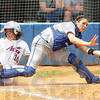 Too late: Indiana State catcher Olivia Andres stretches to catch a ball for an out in action Sunday against the Evansville Aces the throw was late and the Aces scored.