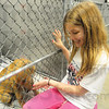 Tribune-Star/Rachel Keyes<br /> Playful pup: Mary Gatrell spends some time playing with one of the puppies at the Humane Shelter.