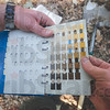 Tribune-Star/Rachel Keyes<br /> Soil sample: Indiana University students are using Munsell Soil Color Charts to give soil color descriptions as they dig for artifact at a Mound near Fairbanks.