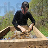 Tribune-Star/Rachel Keyes<br /> Hunt for the past: Indiana University student Nicole Wittlief uses a mesh tray to search for artifacts as part of a field research team working on a Mound in Fairbanks.