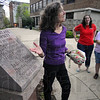 Tribune-Star/Jim Avelis<br /> Good luck charm: Nan McEntire explains the legends behind the typographical error on a granite marker on the ISU ampus. About thirty ghost enthusiasts took part in the English professors' ghost walk last week.