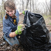 Tribune-Star/Rachel Keyes<br /> Bag it up: St. Mary's student Emma Bird bags up trash as part of a clean up project sponsored by The Woods Sustainability Club.