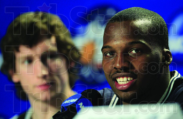 Butler guard Shelvin Mack speaks during a news conference as forward Matt Howard, left, looks on before a practice session for the men's NCAA Final Four college basketball championship game Sunday, April 3, 2011, in Houston. Butler plays Connecticut in the championship game Monday night.  (AP Photo/Mark Humphrey)