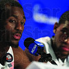 Connecticut's Kemba Walker, left, speaks during a news conference as teammate Roscoe Smith looks on before a practice session for the men's NCAA Final Four college basketball championship game Sunday, April 3, 2011, in Houston. Connecticut plays Butler in the championship game Monday night. (AP Photo/Mark Humphrey)