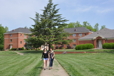 Sophomores Mason Smith and Elisa Beekman take in the sunshine and the smell of fresh cut grass on their way to class.