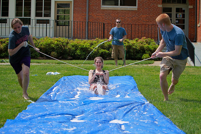 Students enjoy a waterslide on the quad, presented on as an Economics project for class.