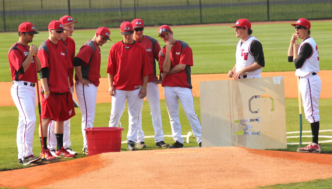 A host of Gardner-Webb players prepare the field before their game against Charleston Southern.