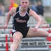 Tribune-Star/Jim Avelis<br /> No barriers: Brave hurdler Lexie Carlson competes in the 100 high hurdles at the Braves Invitational Friday evening.