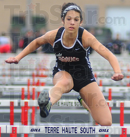 Tribune-Star/Jim Avelis<br /> Leaper: Tasia Brewer won her heat at the Braves Invitational track meet Friday evening.