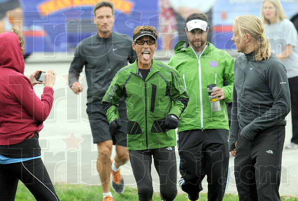 Run: Dean Karnazes is introduced to the field of runners that participated in the 5K run starting at Terre Haute North Friday morning.
