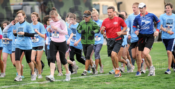 Finish: Dean Karnazes (in green) finishes the 5K race with a pack of runners at North High School Friday morning.