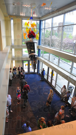 """Tribune-Star/Jim Avelis<br /> Unveiled: """"The Fire Within"""" an acrylic and steel sculpture by Jack Fox was unveiled Friday. The work hangs in the south entrance to the student recreation center on the ISU campus."""