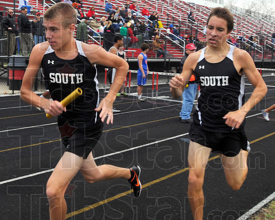 Tribune-Star/Jim Avelis<br /> Your turn: Logan Hambrock takes off on the third leg of the 4x800 relay at teh Braves Invitational track meet. He recievd the baton from teammate Jackson Bertoli.