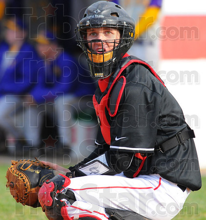 Tribune-Star/Jim Avelis<br /> Looking for a sign: Braves catcher Preston Tofaute looks to the bench for the next pitch to ask for.