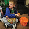 Tribune-Star/Rachel Keyes<br /> Soggy socks: Six-year-old Ashton Kamp complains about his soggy socks as he counts his Easter eggs after a family hunt at Collett Park.