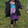 Tribune-Star/Rachel Keyes<br /> Rain go away: Izabela Bockhold chases after an Easter egg at Collett Park Friday evening.