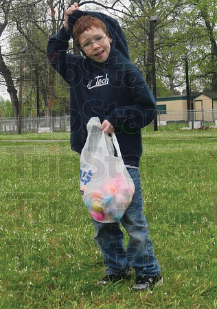 Tribune-Star/Rachel Keyes<br /> Enduring the elements: Ten-year-old Matt Mize pull his hood up to shield his head from the rain at a family Easter egg hunt on Friday.