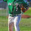 Tribune-Star/Jim Avelis<br /> On defense: West Vigo third baseman Nolan Flibb throws out a North Central batter from across the diamond.
