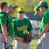 Tribune-Star/Jim Avelis<br /> Let's talk: North Central coach Craig Grow, second from left, calls a meeting on the mound in the tough second inning against West Vigo. With him are catcher Cole Johnson, Danile LOveall(14), pitcher Connor Strain and Zach Lyday(7).