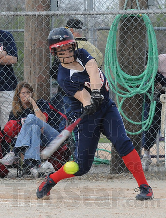 Tribune-Star/Rachel Keyes<br /> Battle it out: Terre Haute North's Lorrie LaTourette battles it out at the plate in Friday night's game against North Central.