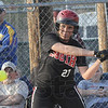 Tribune-Star/Rachel Keyes<br /> Hit it: Terre Haute South's Kaitlyn Pluta swings at a pitch in action Friday night at the Braves Bash 2011.