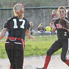 Tribune-Star/Rachel Keyes<br /> Stop: Terre Haute South's Kelsey Marlow throw to South's Jena Renteria for an out at second in action Friday night.