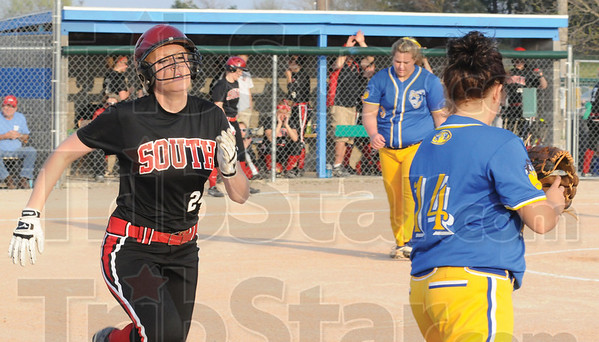 Tribune-Star/Rachel Keyes<br /> Dig: Terre Haute South's Shelbie Scamihorn make a run into first base in action Friday evening.