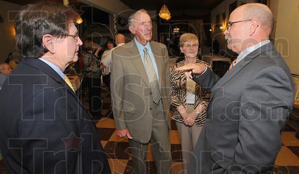 Tribune-Star/Jim Avelis<br /> Former comrades: Clyde Kersey, along with Vern and Linda Tincher, chat with Former Indiana House Speaker John Gregg before the Jefferson-Jackson dinner Friday evening.