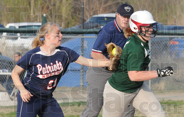 Tribune-Star/Rachel Keyes<br /> Tag out: Terre Haute North's Abby Middleton tags out one of North Central's players in action Friday night.
