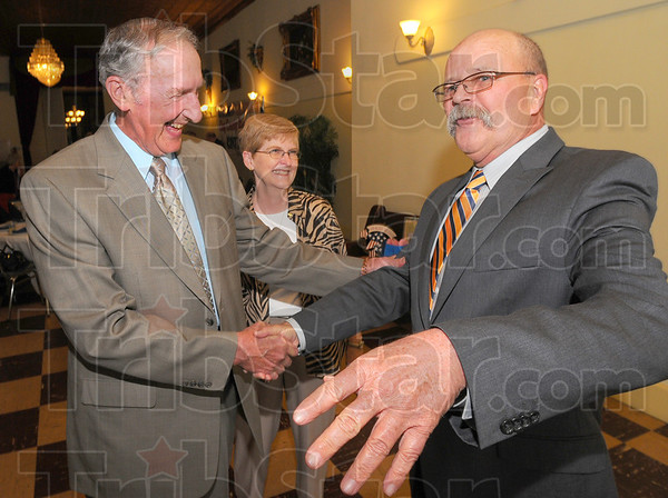 Tribune-Star/Jim Avelis<br /> Old friends: Vern Tincher, and his wife Linda share a laugh with John Gregg before the Clay County Jefferson-Jackson dinner.
