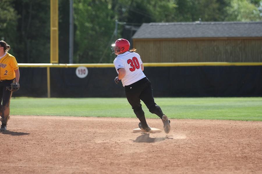 Number 30, Morgan Baker, rounding second base.