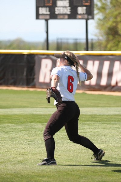 Number 6, Jane Savage, fielding the ball.
