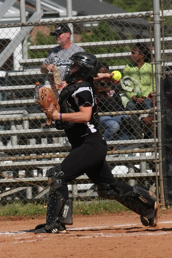 Catcher, number 17, McKenzie Morenus throws down to second.