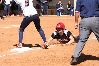 Samantha Meenaghan sliding back to third.