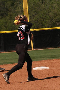 Number 13, Jordyn Arrowood, throws to first.