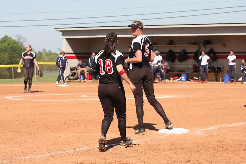 Number 18, Kelsey Witter, comes for the back up at third.