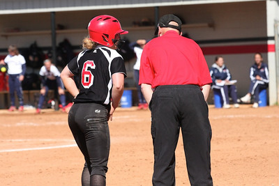 Coach Cole talks to Jane after her triple.