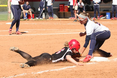 Number 6, Jane Savage, slides safe into third.
