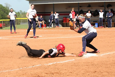 Number 6, Jane Savage, sliding into third for the triple.
