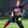 Tribune-Star/Rachel Keyes<br /> Defense: Terre Haute South's Rebecca Latta gets a stop in action Saturday against Henderson.