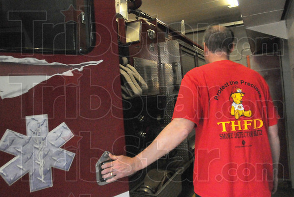 Tribune-Star/Rachel Keyes<br /> Protect the Precious: Terre Haute Firefighter Rich Gallagher sport a T-shirt for the Protect the Precious campaign. A campaign to bring awareness to the importance of smoke detectors.