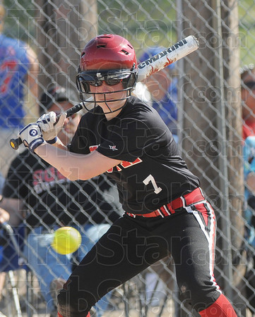 Tribune-Star/Rachel Keyes<br /> Swing: Terre Haute South's Cheyenne Reinig gets ready to swing at a pitch in action Saturday.
