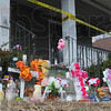 Tribune-Star/Jim Avelis<br /> Remembering: A small shrine has grown in front of the home on South Ninth Street, scene of an early Saturday morning fire that has claimed three lives.