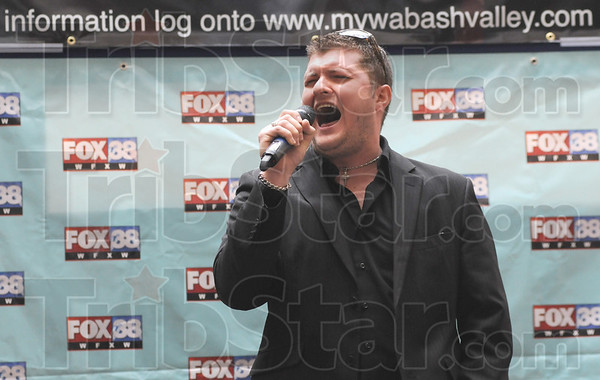 """Tribune-Star/Rachel Keyes<br /> Belt it out: Tom Kelly belts out Marvin Gaye's """"Heard it Through the Grapevine"""" for his 30 second audition in the X-Factor try-outs Saturday at Honey Creek Mall hosted by FOX-38."""